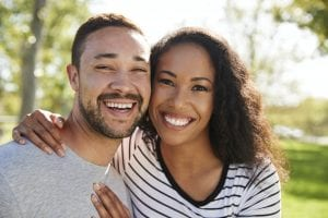 What is Gum Recession and Grafting? Mountainview Periodontics in parker, co, periodontics of cherry creek in glendale, co Dr. Maryanne Butler, Dr. Amy Riffel Outdoor Head And Shoulders Portrait Of Smiling Couple In Park
